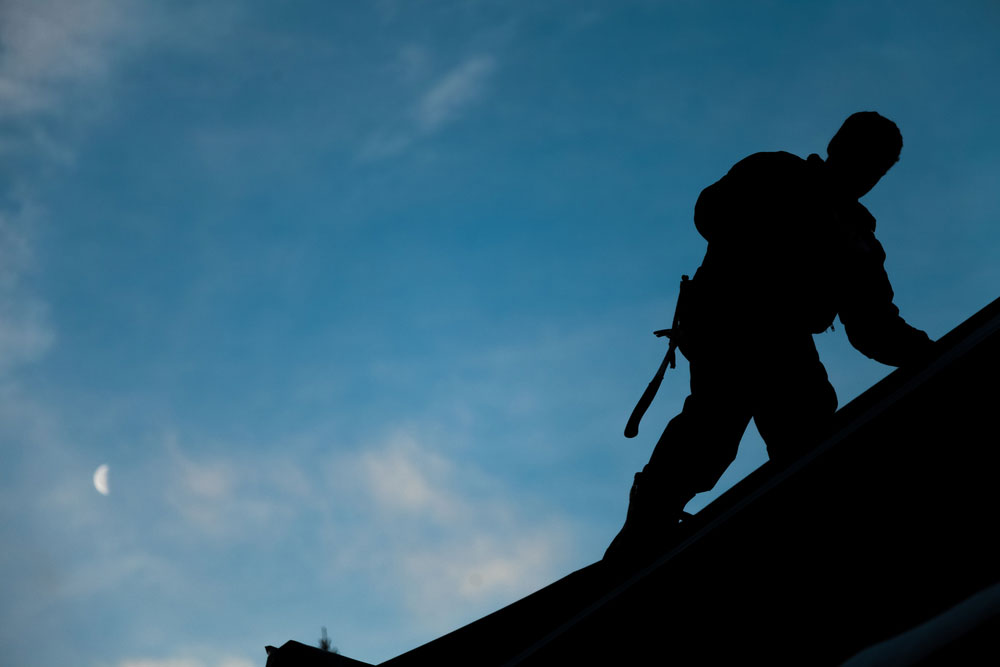 silhouette of a roofer
